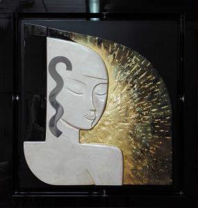 Panneau de bois sculpté, laque et feuilles d'or